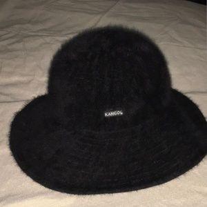 A pair of matching black Kangol hat /purse